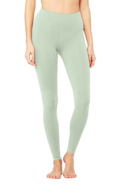 0ea554f7436c8f Alo Yoga Elevate sport leggings with contrast colorblock panels for  body-sculpting effect. Contrast sides; shiny panels at bottom. Banded waist.